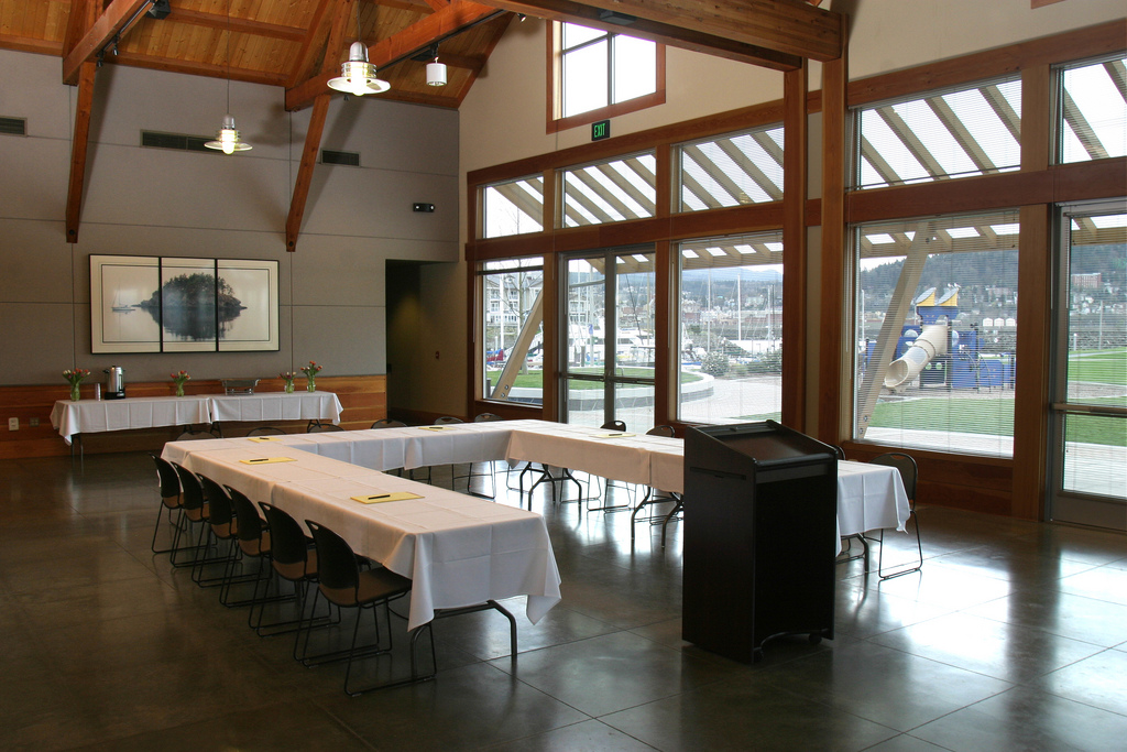 Table and podium set up in the Squalicum Boathouse