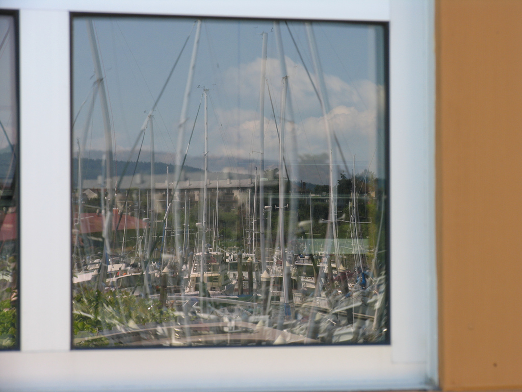 Squalicum Harbor reflected in the boathouse window