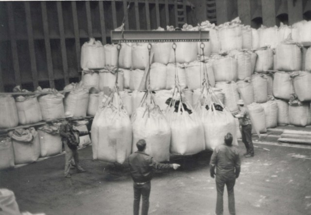 Bagged cargo is loaded aboard a ship.