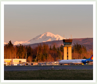 Bellingham airport with control tower and mt baker in the backgroud